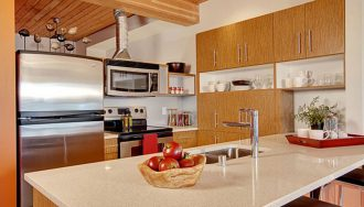 kitchen-kitchen-decorating-ideas-in-small-apartment-with-white-granite-countertops-on-beautiful-islands-with-washbasin-with-aluminum-washer-faucet-small-apartment-kitchen-design-ideas-in-modern-home-deco